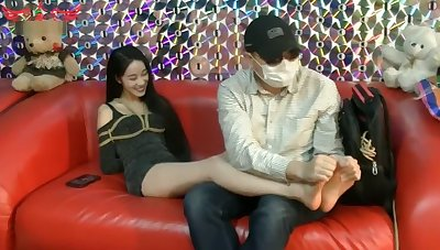 Asian girl boots removed increased by tickled