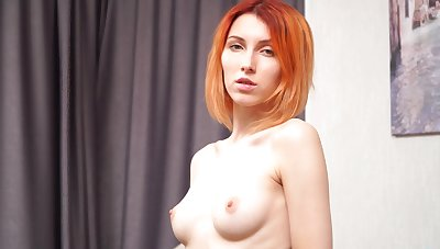 Redhead hottie Elina Holm enjoys fingering say no to pussy vulnerable an obstacle sofa