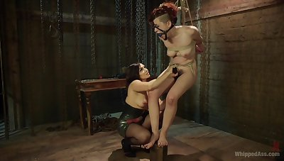 Enslaved girl endures mistress's brutal fisting with an increment of toy fucking