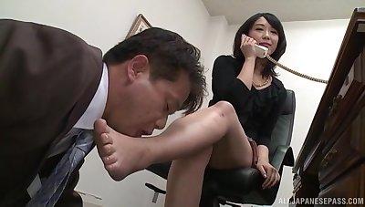 Kinky Japanese Nijikawa Sora on her knees pleasuring a swayed dick