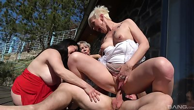 Slim matures share the dick in sunny outdoor fetish scenes